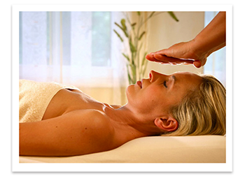 woman participating in reiki energy healing